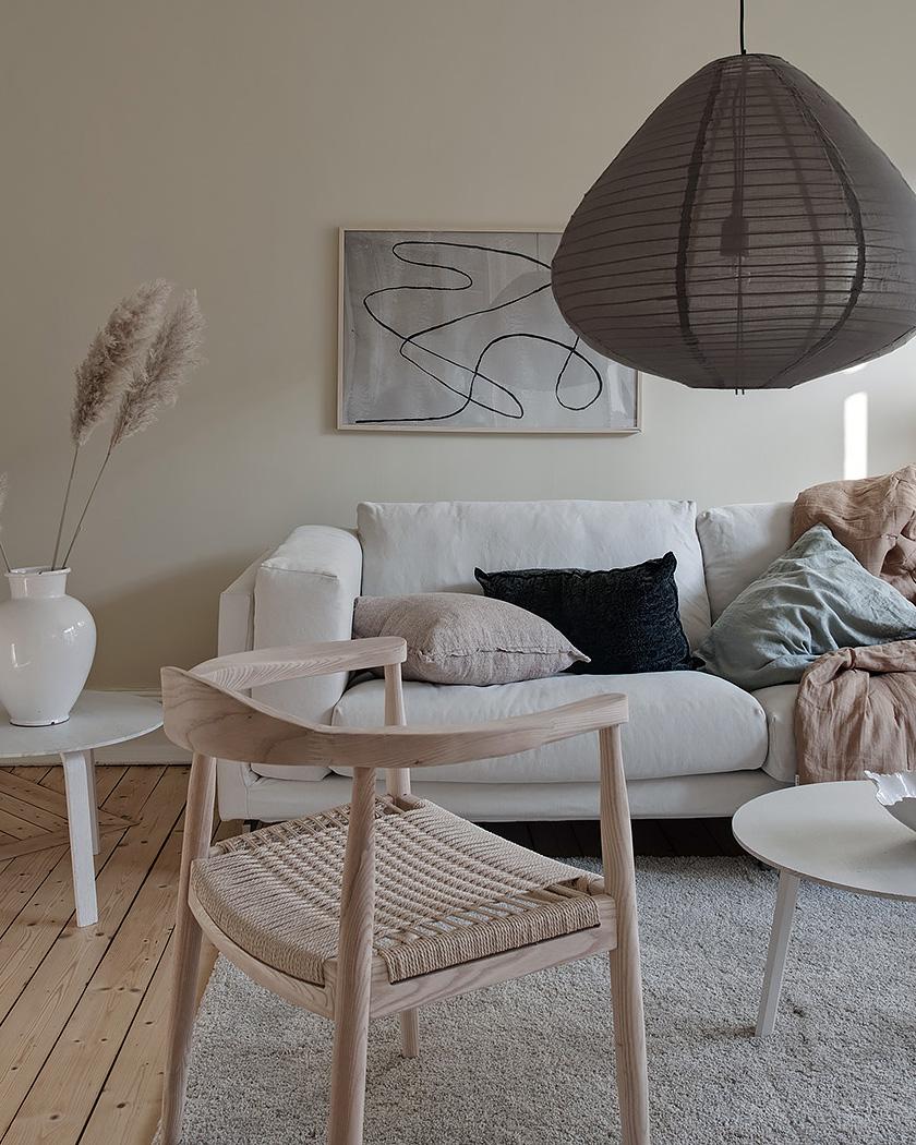 salon scandinave beige fauteuil bois clair