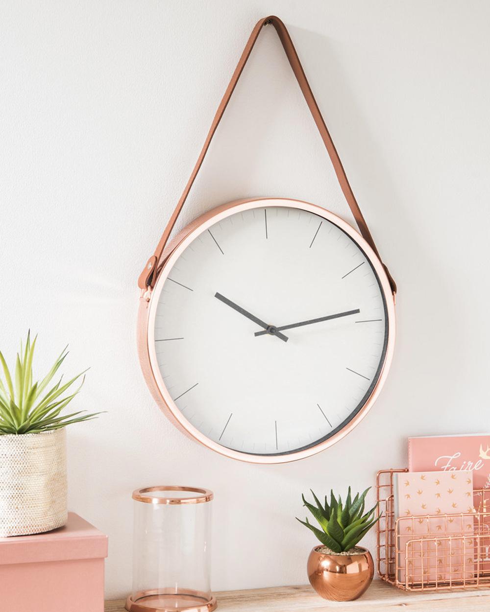 horloge ronde en cuir et cuivre